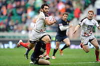 Philip Mack of Canada flies through the Argentinian defence to score a try during Day Two of the iRB Marriott London Sevens at Twickenham on Sunday 11th May 2014 (Photo by Rob Munro)