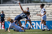 Sanford, FL - Saturday Oct. 14, 2017:  A Pride defender slides to challenge for the ball during a US Soccer Girls' Development Academy match between Orlando Pride and NC Courage at Seminole Soccer Complex. The Courage defeated the Pride 3-1.