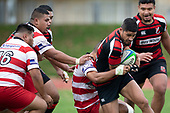 Rodney Tongotea tackles Onni Mesake. Counties Manukau Premier Club Rugby game between Papakura and Karaka played at Massey Park Papakura on Saturday May 5th 2018. Papakuar won the game 28 - 25 after trailing 6 - 12 at halftime.<br /> Papakura - Faalae Peni, Darryl Hemopo, George Crichton, Federick Cain tries, Faalae Peni conversion; Faalae Peni 2 penalties, Karaka -Salesitangi Savelio, Cardiff Vaega, Walter Fifita tries, Juan Benadie 2 conversions, Juan Benadie 2 penalties.<br /> Photo by Richard Spranger.