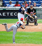 4 July 2009: Washington Nationals outfielder Adam Dunn connects for an RBI game winning single in the 8th inning against the Atlanta Braves at Nationals Park in Washington, DC. Dunn previosly hit his 300th career home run as the Nationals rallied with 4 runs in the 8th inning to defeat the Braves 5-3 and take the second game tying the 3-game weekend series. Mandatory Credit: Ed Wolfstein Photo