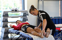 Pictured: Ben Davies is being examined by one of the squad physiotherapists. Wednesday 02 July 2014<br />