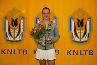 Rotterdam, The Netherlands, 15.03.2014. NOJK 14 and 18 years ,National Indoor Juniors Championships of 2014, Trophy giving on court, runner up girls 18 years Inger van Dijkman<br /> Photo:Tennisimages/Henk Koster