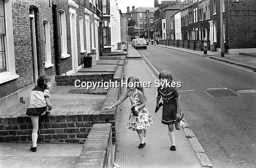 Children, girls playing in the street. Elephant and Castle, SE London. 1970s  Uk <br /> <br /> L to R, sisters Emma and Clare Sullivan, with friend Cherie Badham (married name Cherie Corriganin, in centre )outside Cherie's home 27 Hayles Street, Kennington, Elephant and Castle, London.<br /> <br /> Thanks to Cherie Corriganin.