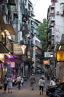 Pedestrians walking through the historic center of Macao.<br />