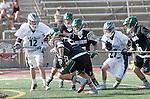 La Canada Flintridge, CA 03/16/13 - Jackson Teague (De La Salle #12), Daniel Dodd (De La Salle #27), c28\ and Jake Shepherd (Coronado #30) in action during the De La Salle vs Coronado lacrosse game at St Francis High School.  De La Salle defeated Coronado 8-5.
