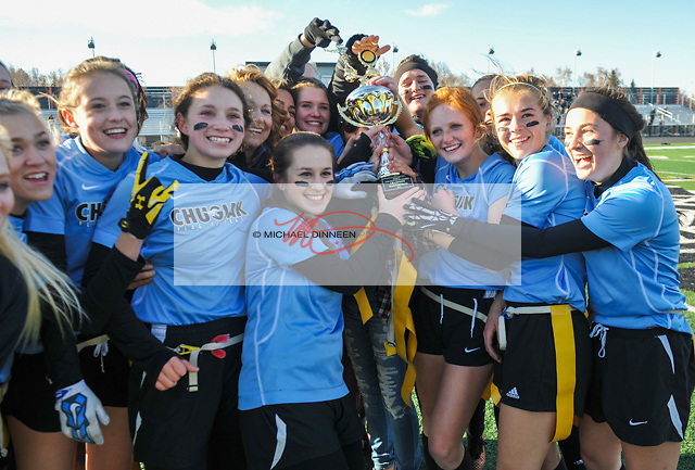 The Chugiak Mustangs hold their trophy following their state champions5hip win at West High Saturday, October 15, 2016.  Photo for the Star by Michael Dinneen