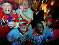 Clockwise, Nick Rohr, 21, of Millstadt, IL, John Garrett, 21, of Columbia, IL, Arturo Holmes II, 26, and Daniel Carthen, 26, both of St. Ann, cheer for the St. Louis Cardinals in Joey B's on the Landing during game 5 of the World Series at Busch Stadium. The Cardinals won the game 4-2 and the World Series championship on Friday, October 27, 2006.