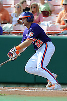 Catcher Spencer Kieboom #22 swings at a pitch during a  game against the Miami Hurricanes at Doug Kingsmore Stadium on March 31, 2012 in Clemson, South Carolina. The Tigers won the game 3-1. (Tony Farlow/Four Seam Images).