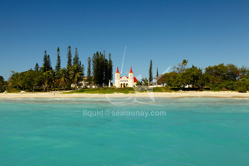 "View from the lagoon of the Fayaoue Catholic church on the ouvea island in the Loyalty islands..Ouvéa (local pronunciation: [u?ve.a]) is a commune in the Loyalty Islands Province of New Caledonia, an overseas territory of France in the Pacific Ocean. The settlement of Fayaoué [fa?jawe], on Ouvéa Island, is the administrative centre of the commune of Ouvéa..Ouvéa is made up of Ouvéa Island, the smaller Mouli Island and Faiava Island, and several islets around these three islands. All these lie among the Loyalty Islands, to the northeast of New Caledonia's mainland..Ouvéa Island is one of the Loyalty Islands, in the archipelago of New Caledonia, an overseas territory of France in the Pacific Ocean. The island is part of the commune (municipality) of Ouvéa, in the Islands Province of New Caledonia..The crescent-shaped island, which belongs to a larger atoll, is 50 km (30 miles) long and 7 km (4.5 miles) wide. It lies northeast of Grande Terre, New Caledonia's mainland..Ouvéa is home to around 3,000 people that are organized into tribes divided into Polenesian, Melanesian and Walisian by ethnic descend. The Iaai language is spoken on the island..The two native languages of Ouvéa are the Melanesian Iaai and the Polynesian Faga Uvea, which is the only Polynesian language that has taken root in New Caledonia. Speakers of Faga Uvea have fully integrated into the Kanak society, and consider themselves Kanak..Ouvéa has rich marine resources and is home to many sea turtles, species of fish, coral as well as a native parrot, the Uvea Parakeet, that can only be found on the island of Ouvéa..A large crustacaen called a ""coconut crab"" or crabe de cocotier can also be found on the islands. The large crabs live in palm tree plantations and live solely on a diet of coconuts that they crack open with their powerful claws. They are blue in colour and can grow to several kilos in size. They are a land based species and do not venture into the ocean..Ouvéa is also home to trophy Bonefish"
