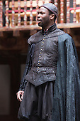 London, UK. 25 April 2015. Stefan Adegbola as Launcelot Gobbo. William Shakespeare's The Merchant of Venice is performed at Shakespeare's Globe, Globe Theatre, from 23 April - 7 June 2015. With Daniel Lapaine as Bassanio, Rachel Pickup as Portia and Jonathan Pryce as Shylock. Photo: Bettina Strenske