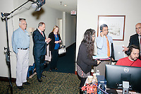Former Virginia governor and Republican presidential candidate Jim Gilmore waits for an interview with TheRealNews.com at the Radisson Hotel's Radio Row in Manchester, New Hampshire, on Mon., Feb. 8, 2016. Also pictured is Gilmore's NH state director Anne Smith, of Bedford, NH, (blond, center) and Gilmore's brother-in-law, Lloyd Gatling, of Suffolk, Virginia (left). Many television and radio stations set up in the hotel for their coverage of the primary in the final days of the campaign. Gilmore finished in last place among major Republican candidates still in the race with a total of 150 votes.
