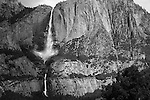"""Yosemite Falls Waterfall"" Mono Chrome Yosemite National Park, California. THIS A ONE OF A KIND OF YOSEMITE FALLS WATERFALL!  The difference between this and my Vertirama version is the sizing and it's a single horizontal photograph shot in mono chrome format. I spent two weeks in the Spring of 2013 climbing up the opposite canyon's wall in order to get an angle that captured all three sections of the waterfall.  I learned on the Yosemite National Park's website that no one had a photograph of the middle section of the waterfall.  Their description of the middle section is ""often ignored middle section""  All other photographers only have photographs showing an angle that has the upper and lower sections in view."
