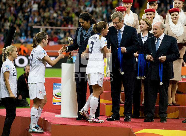 Heather O'Reilly, Steffi Jones, Christie Rampone, officials, Sepp Blatter.  Japan won the FIFA Women's World Cup on penalty kicks after tying the United States, 2-2, in extra time at FIFA Women's World Cup Stadium in Frankfurt Germany.