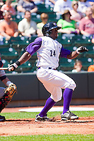 Jared Mitchell #24 of the Winston-Salem Dash follows through on his swing against the Kinston Indians at BB&T Ballpark on April 17, 2011 in Winston-Salem, North Carolina.   Photo by Brian Westerholt / Four Seam Images