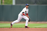 Cedar Rapids Kernels shortstop Jermaine Palacios (16) fields a ground ball during the first game of a doubleheader against the Kane County Cougars on May 10, 2016 at Perfect Game Field in Cedar Rapids, Iowa.  Kane County defeated Cedar Rapids 2-0.  (Mike Janes/Four Seam Images)