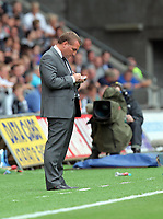 Pictured: Brendan Rodgers manager for Swansea making notes on the touchline. Saturday 27 August 2011<br /> Re: Premiership Swansea City FC v Sunderland at the Liberty Stadium, south Wales.