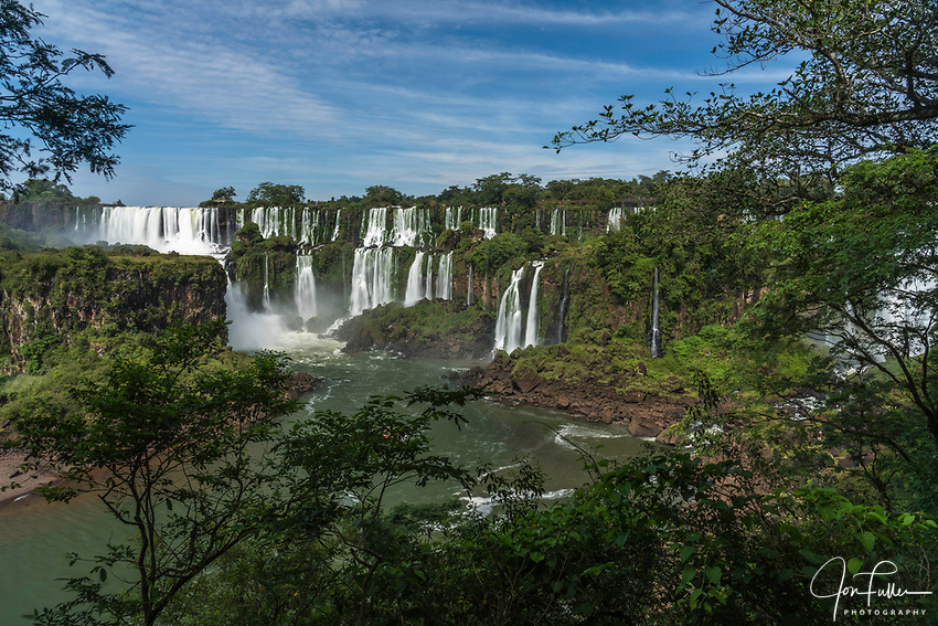 The powerful San Martin Waterfall at left with Mbigua Falls at center in Iguazu Falls National Park in Argentina.   A UNESCO World Heritage Site.