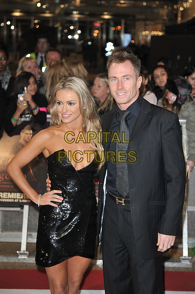 Ola Jordan, James Jordan.'The Twilight Saga: Breaking Dawn - Part 1' UK film premiere at Westfield Stratford City, London, England..16th November 2011.half length black strapless dress cleavage suit sequins sequined hand on hip married husband wife .CAP/MAR.© Martin Harris/Capital Pictures.