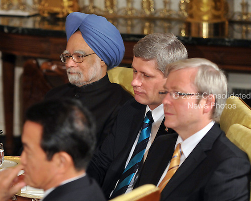 Washington, D.C. - November 14, 2008 -- From top left: President Manmohan Singh of India; Prime Minister Stephen Joseph Harper of Canada;  Prime Minister Kevin Rudd of Australia; and Prime Minister Taro Aso of Japan listen as United States President George W. Bush makes remarks to the Summit on Financial Markets and the World Economy on the North Portico of the White House in Washington, D.C. on Friday, November 14, 2008..Credit: Ron Sachs / Pool via CNP
