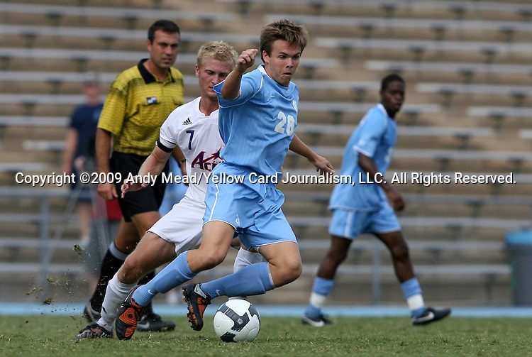 06 September 2009: UNC's Alex Waters (28) and Evansville's Robby Lynch (7). The University of North Carolina Tar Heels defeated the Evansville University Purple Aces 4-0 at Fetzer Field in Chapel Hill, North Carolina in an NCAA Division I Men's college soccer game.