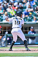 Charlotte Knights second baseman Yoan Moncada (10) awaits a pitch during a game against the  Gwinnett Braves at BB&T Ballpark on May 7, 2017 in Charlotte, North Carolina. The Knights defeated the Braves 7-1. (Tony Farlow/Four Seam Images)