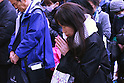 People take part in a moment of silence at 2:46 pm on the fifth anniversary of the Great East Japan Earthquake and Tsunami disaster at Ginza shopping district on March 11, 2016, Tokyo, Japan. Almost 19,000 people lost their lives as a result of the magnitude 9.0 earthquake and subsequent tsunami that hit Japan's north east coast 5 years ago. Five years after the event some 174,000 survivors are still in temporary accommodation. This includes nearly 100,000 from Fukushima who have not been able to return home as a result of the effects of the tsunami and nuclear catastrophe that ensued. (Photo by Shingo Ito/AFLO)