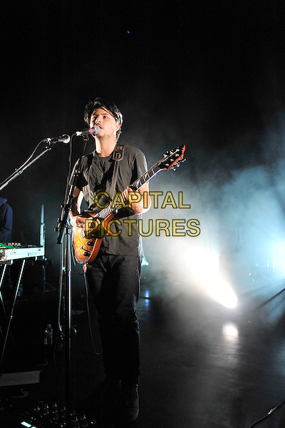 Jamie Woon .Performing live in concert at Shepherds Bush Empire, London, England, UK, .9th June 2011..full length music gig on stage singing playing microphone  guitar black t-shirt .CAP/MAR.© Martin Harris/Capital Pictures.