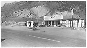 View from across highway of Newberry's Store with gas pumps and 2 autos.<br /> Cimarron, CO  Taken by Newberry, Joe