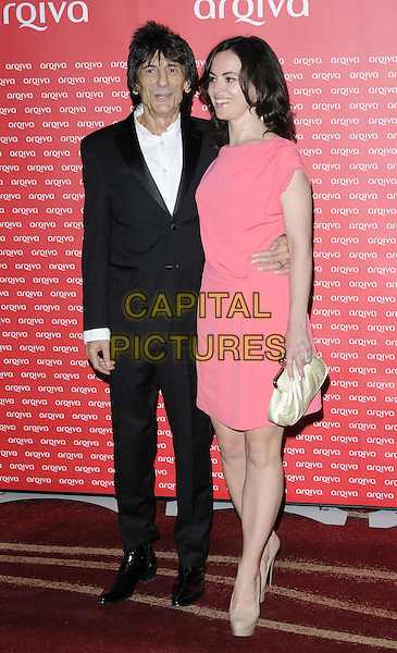 Ronnie Wood & Sally Humphreys.The Arqiva Commercial Radio Awards, Park Plaza Westminster Bridge Hotel, Westminster Bridge, London, England..July 4th, 2012.full length white shirt black suit pink dress couple .CAP/CAN.©Can Nguyen/Capital Pictures.