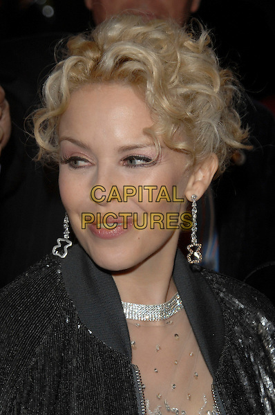 "KYLIE MINOGUE.Attending the ""White Diamond"" UK film premiere Vue West End cinema, Leicester Square, London, England, .16th October 2007. .portrait headshot earrings black coat jacket.Ref: CAP/PL.©Phil Loftus/Capital Pictures"