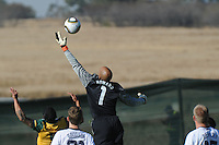 U.S. goalkeeper goes high to cut off a ball over the top intended for Australian forward Tim Cahill. The U.S. won the match, 3-1, played June 5th, in Ruimsig Stadium,  at Roodepoort, South Africa.