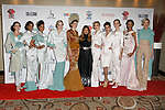 Mayalsian fashion designer Sara Jamaludin poses with models after her Sara Jamaludin collection fashion show for Couture Fashion Week Spring 2018 at the Crowne Plaza Times Square in Manhattan, on September 8, 2017; during New York Fashion Week.