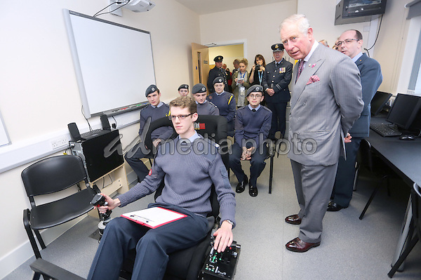 17 February 2016 - Redcar, United Kingdom - Prince Charles The Prince of Wales observes a flight simulation lesson while visiting the new Redcar Joint Cadet Facility to meet young cadets from the Army Cadet Force and the Air Training Corps. His Royal Highness heard about their training and role in the local community. Photo Credit: Alpha Press/AdMedia