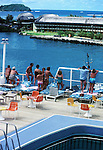 Passengers viewing Rainmaker hotel, Pago Pago from the aft end of a cruise ship 1980.American Samoa, United States