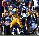 BROOKINGS, SD - OCTOBER 26:  Je Ryan Butler #22 from South Dakota State University returns a punt past Logan Bieghler #53 and Joe Feldpausch #2 from Northern Iowa in the first quarter of their game Saturday afternoon at Coughlin Alumni Stadium in Brookings. Butler ran the punt back 80 yards for a touchdown. (Photo by Dave Eggen/Inertia)