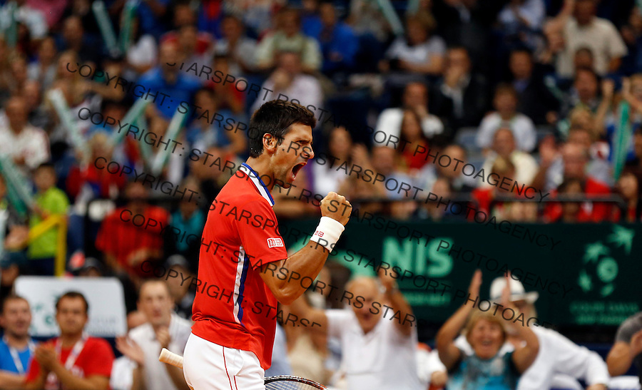 Tennis Tenis<br /> Davis Cup semifinal polufinale<br /> Serbia v Canada<br /> Novak Djokovic v Vasek Pospisil<br /> Novak Djokovic reacts<br /> Beograd, 13.09.2013.<br /> foto: Srdjan Stevanovic/Starsportphoto &copy;