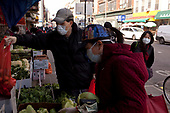 New York, New York<br /> March 18, 2020<br /> 12:48 PM<br /> <br /> Manhattan under coronavirus pandemic. <br /> <br /> Shoppers wearing face mask and gloves fearing the spread of the virus in downtown Manhattan.