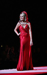 Kristen Chenoweth walks the runway of The Heart Truth's Red Dress Collection on February 11, 2010 at Mercedes-Benz Fashion Week - Fall 2010 Collections at Bryant Park, NYC. (Photo by Sue Coflin/Max Photos)