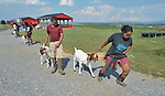 Sara Goitom (right), a resettled refugee from Eritrea, walks her goat on a farm in Linville, Virginia, on July 18, 2017. Goitom and other refugee youth, resettled in the area by Church World Service, are preparing to show sheep and goats in a county fair.<br /> <br /> Photo by Paul Jeffrey for Church World Service.
