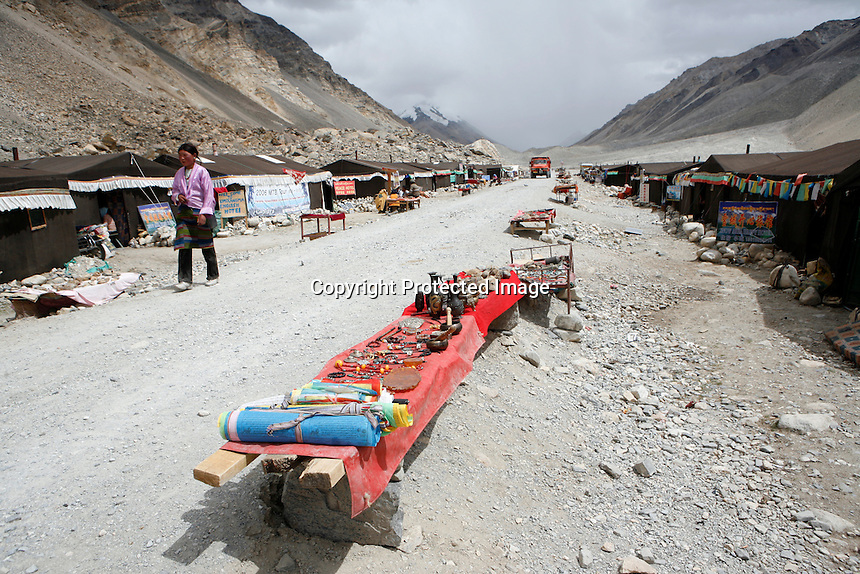 China started building a controversial 67-mile &quot;paved highway fenced with undulating guardrails&quot; to Mount Qomolangma, known in the west as Mount Everest, to help facilitate next year's Olympic Games torch relay./// The tent village guesthouses at Everest Base Camp.<br /> Tibet, China<br /> July, 2007