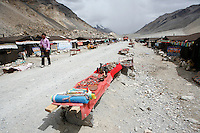 "China started building a controversial 67-mile ""paved highway fenced with undulating guardrails"" to Mount Qomolangma, known in the west as Mount Everest, to help facilitate next year's Olympic Games torch relay./// The tent village guesthouses at Everest Base Camp.<br /> Tibet, China<br /> July, 2007"