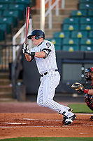 Jackson Generals first baseman Kevin Cron (50) follows through on a swing during a game against the Chattanooga Lookouts on April 27, 2017 at The Ballpark at Jackson in Jackson, Tennessee.  Chattanooga defeated Jackson 5-4.  (Mike Janes/Four Seam Images)
