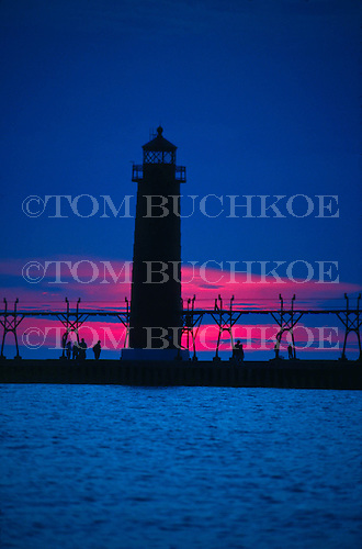 Grand Haven South Pier Lighthouse Michigan at sunset.