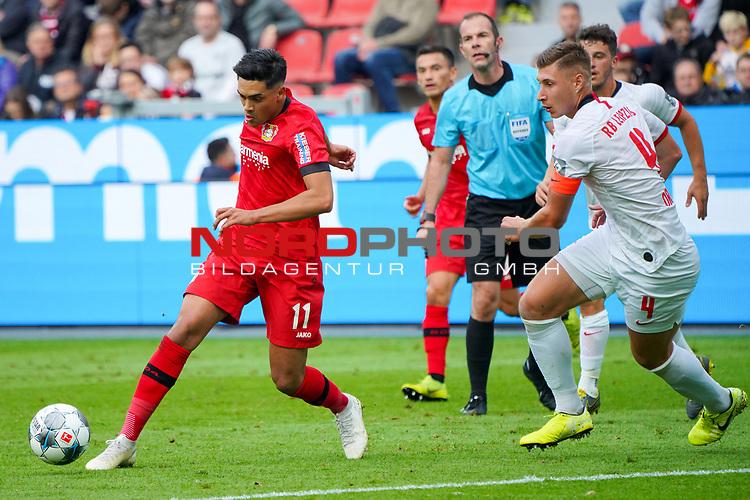 05.10.2019, BayArena, Leverkusen, GER, 1. FBL, Bayer 04 Leverkusen vs. RB Leipzig,<br />  <br /> DFL regulations prohibit any use of photographs as image sequences and/or quasi-video<br /> <br /> im Bild / picture shows: <br /> Nadiem Amiri (Leverkusen #11),  im Zweikampf gegen  Willi Orban (RB Leipzig #4),     <br /> <br /> Foto © nordphoto / Meuter