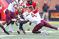 College Park, MD - September 22, 2018: Maryland Terrapins running back Ty Johnson (24) is tackled by Minnesota Golden Gophers defensive back Terell Smith (4)  during the game between Minnesota and Maryland at  Capital One Field at Maryland Stadium in College Park, MD.  (Photo by Elliott Brown/Media Images International)