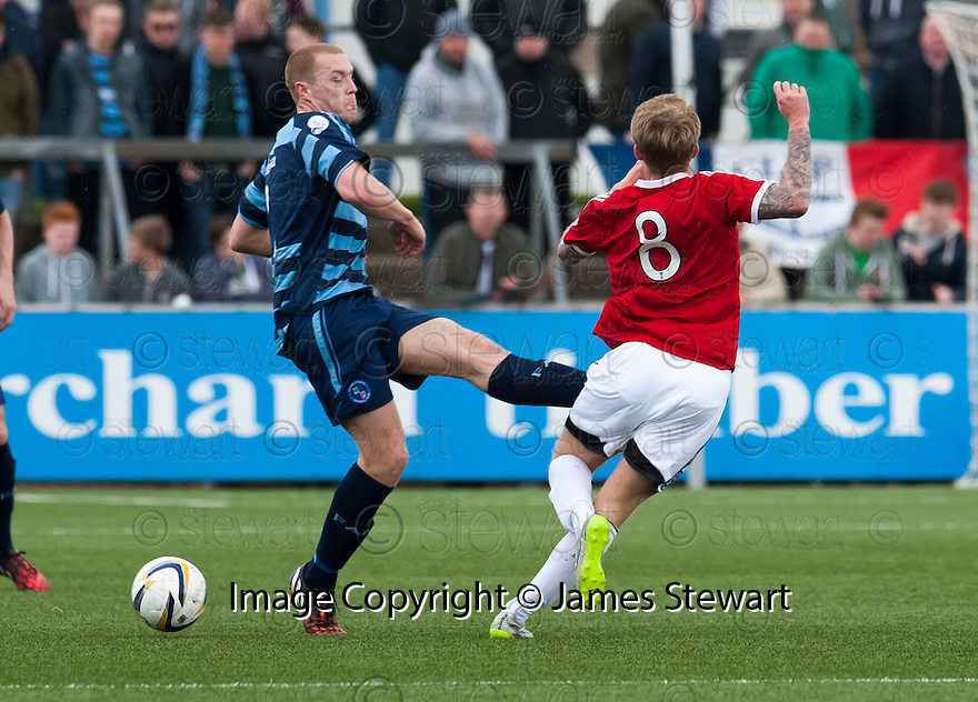 Forfar's Michael Dunlop gets a straight red for this challenge on Ayr Utd's Robbie Crawford.