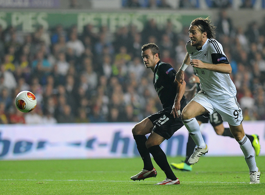 St Gallen's Ivan Martic vies for possession with Swansea City's Michu<br /> <br /> Photo by Ashley Crowden/CameraSport<br /> <br /> Football - Europa League Group A - Swansea City v St Gallen - Thursday 3rd October 2013 - The Liberty Stadium - Swansea<br /> <br /> &copy; CameraSport - 43 Linden Ave. Countesthorpe. Leicester. England. LE8 5PG - Tel: +44 (0) 116 277 4147 - admin@camerasport.com - www.camerasport.com