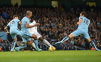 Picture by Howard Roe/AHPIX.com. Football, Barclays Premier League; <br /> Manchester City v Swansea City ;22/11/2014 KO 3.00 pm <br /> Etihad Stadium;<br /> copyright picture;Howard Roe;07973 739229<br /> Swansea's   Wilfried Bony shot is blocked by the City defence