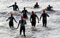 26 SEP 2010 - CLACTON, GBR - Competitors run into the sea at the start of the Clacton Standard Distance Triathlon .(PHOTO (C) NIGEL FARROW)