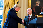 U.S. President Donald J. Trump (L) shakes hands with Attorney General Jeff Sessions (R) shortly after Sessions was sworn by Vice President Mike Pence in the Oval Office of the White House in Washington, DC, USA, 09 February 2017. On 08 February, after a contentious battle on party lines, the Senate voted to confirm Sessions as attorney general.<br /> Credit: Jim LoScalzo / Pool via CNP